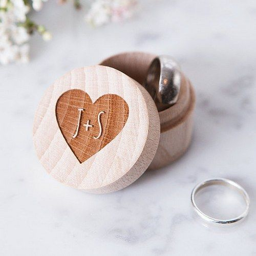 wooden ring box with a cut out heart and monograms