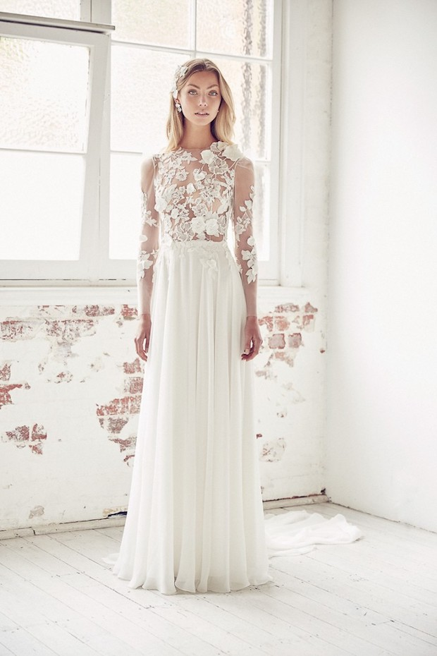 a plain skirt and an illusion bodice with lace appliques and sleeves