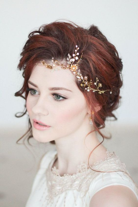 bold red hair updo with a gold and white hair vine on the side