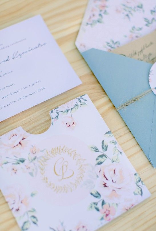 soft pastel wedding stationary with floral patterns