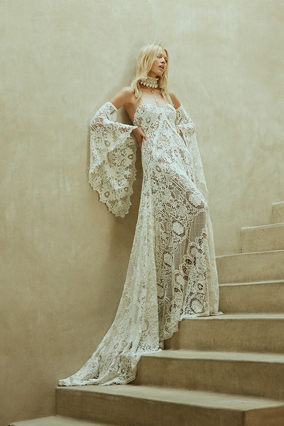 strapless crochet lace wedding dress with a train