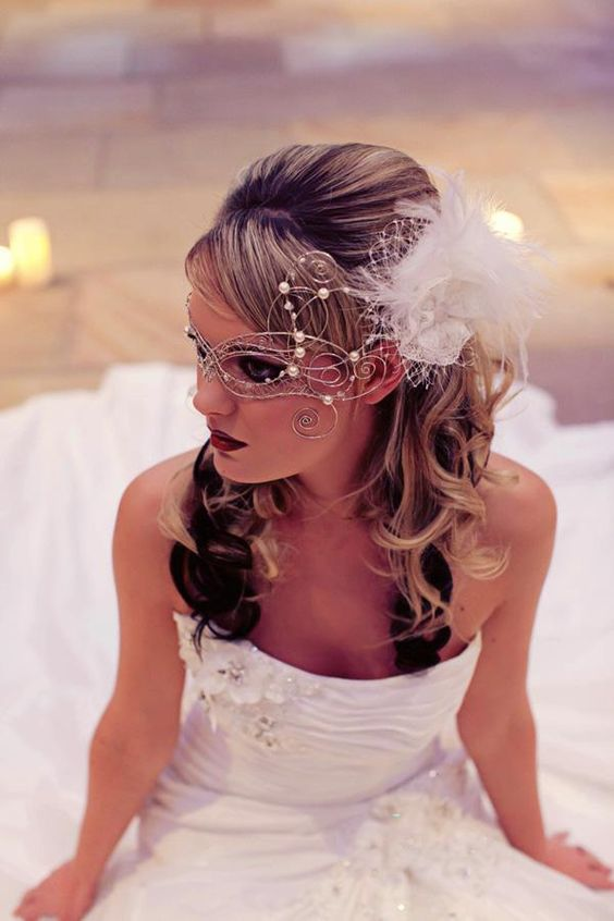 such a stunning delicate masks with pearls and a feather fascinator are right what a bride needs