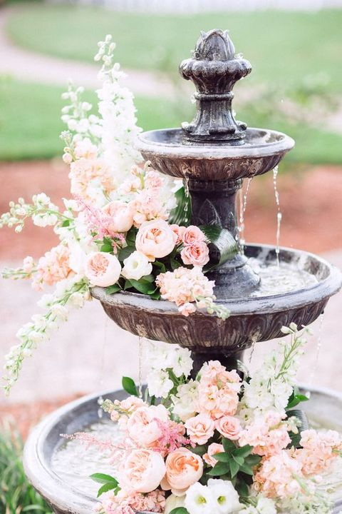 a fountain with lush flowers is right what you need for a refined summer garden affair