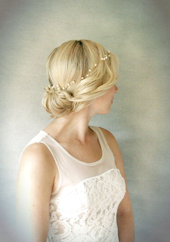 a simple updo with a delicate pearl hair vine