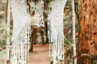 13 birch branch wedding arch with macrame and bold florals