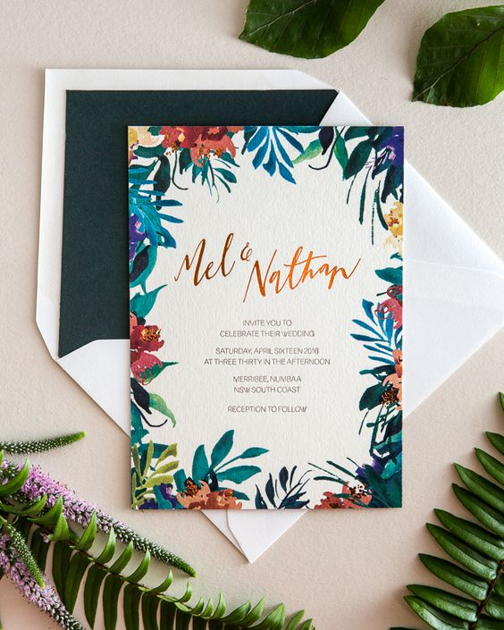 colorful wedding invitation with tropical flowers and a dark green lining envelope
