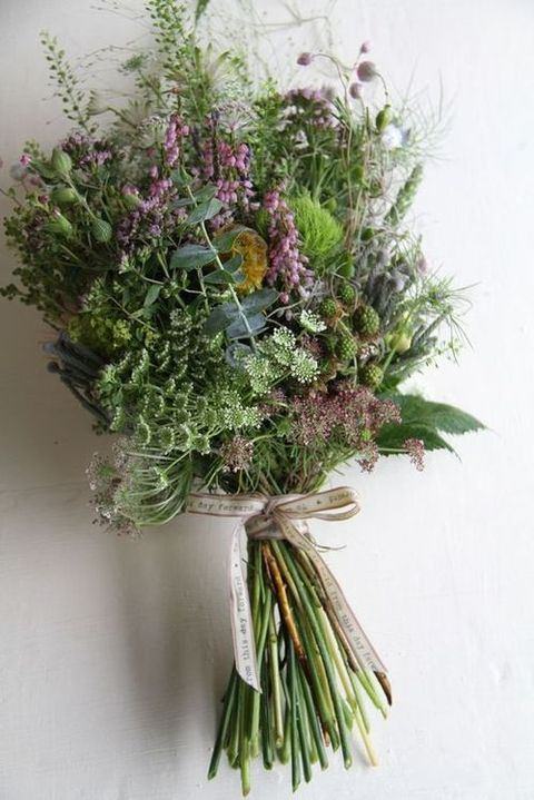 messy herb and greenery wedding bouquet wit wildflowers