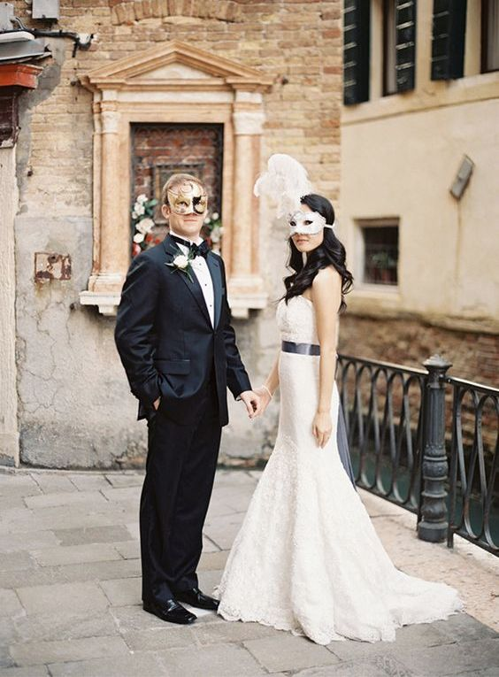 the newlyweds in Venice, in gorgeous Venetian masks