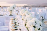 14 elegant all-white tablescape with gold accents