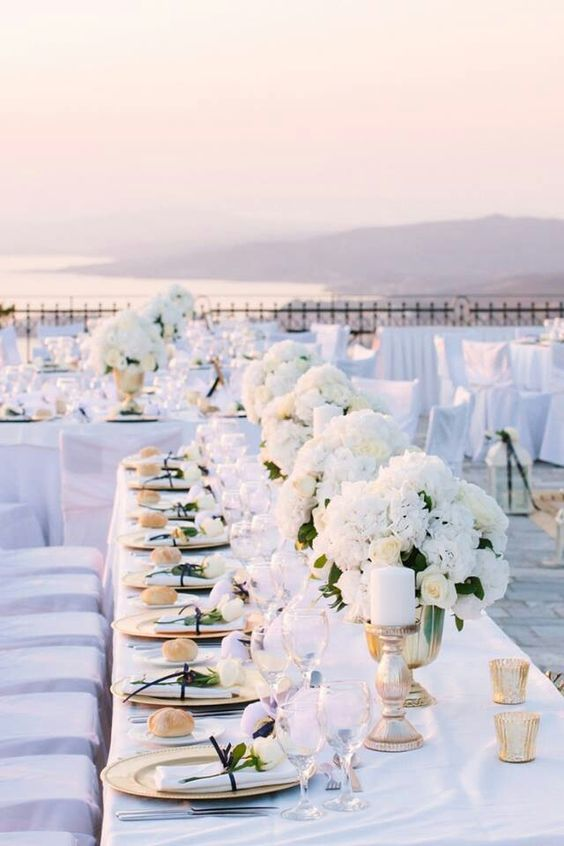 elegant all-white tablescape with gold accents