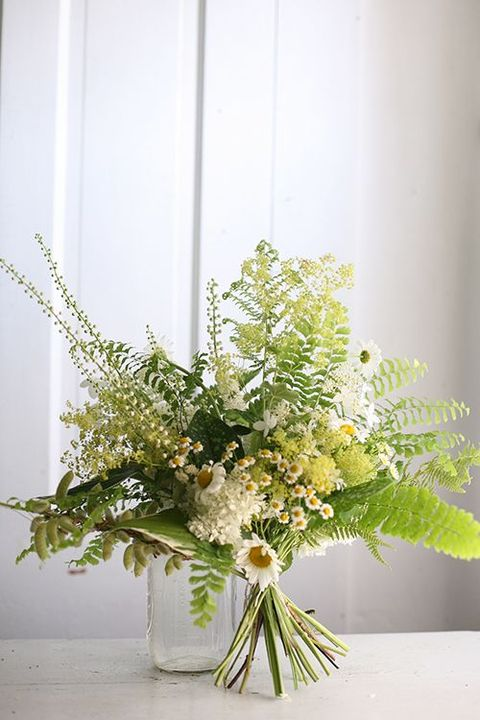 fern and camellias wedding bouquet is very summer-like