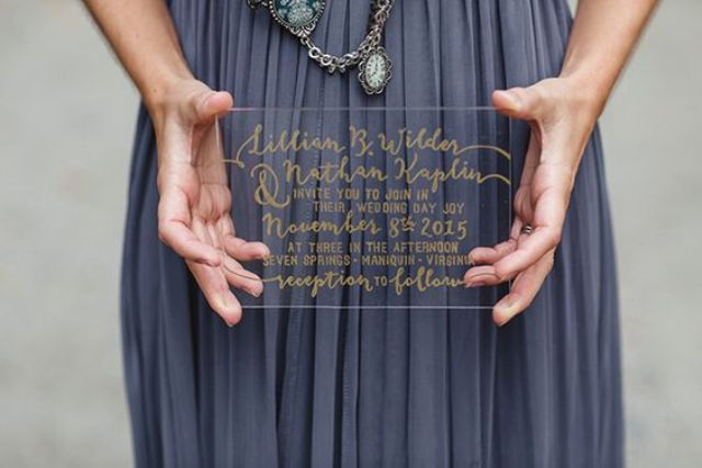 gold calligraphy invitation on lucite for a modern touch