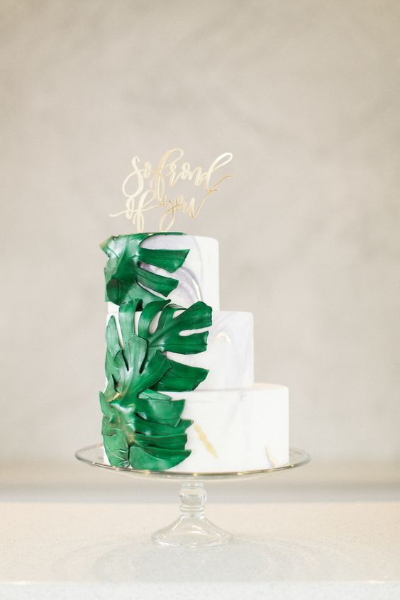 marble wedding cake with palm leaves