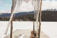 really simple rough wood wedding arch with macrame decor