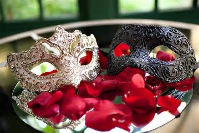 the couple's masks in black and white with a bling