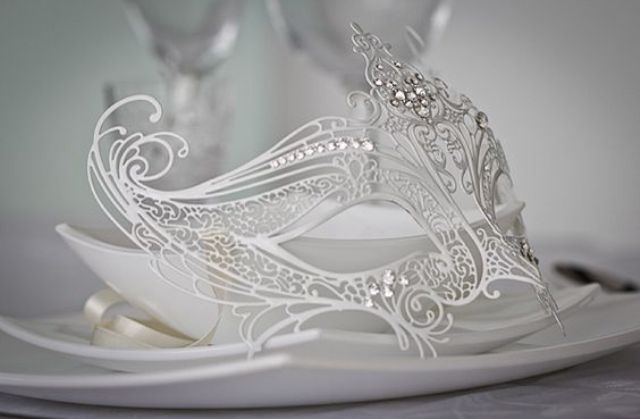 ethereal white bridal mask decorated with rhinestones