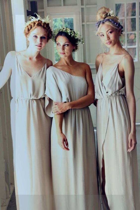 off-white mismatched bridesmaids' dresses and flower crowns