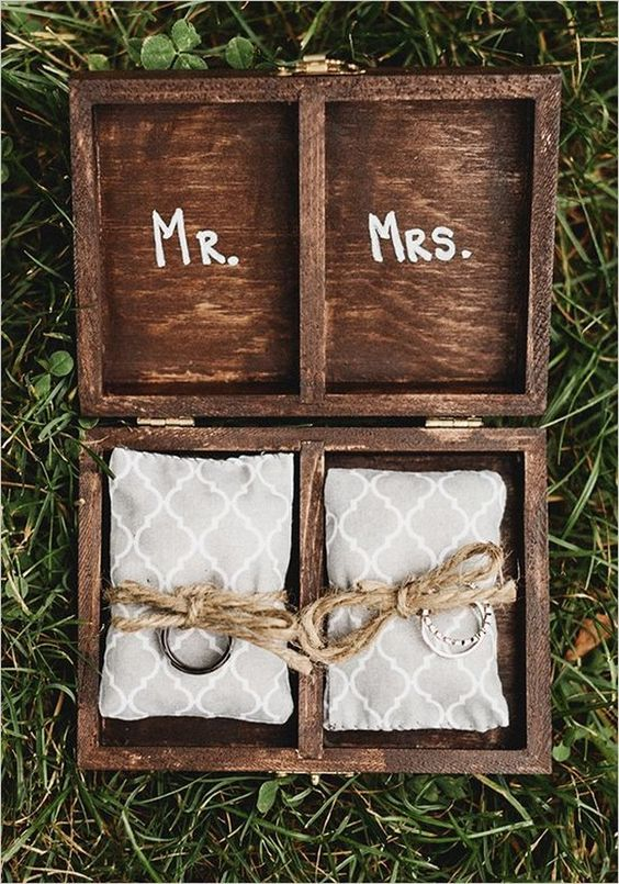 rustic wooden ring box with pillows and twine