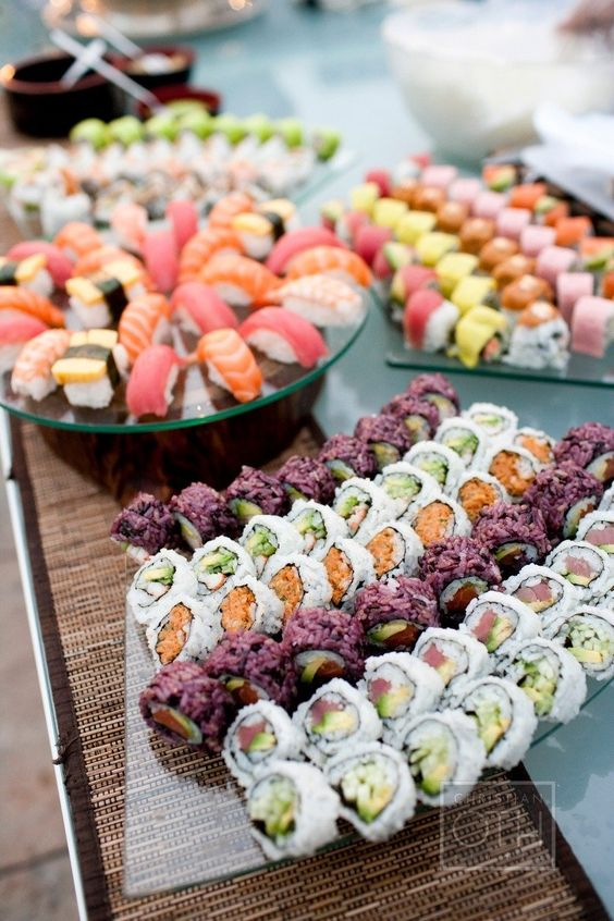 serving sushi on glass plates makes them look even more delicious