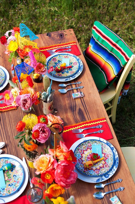 traditionally Mexican bold tablescape with cacti and colorful florals