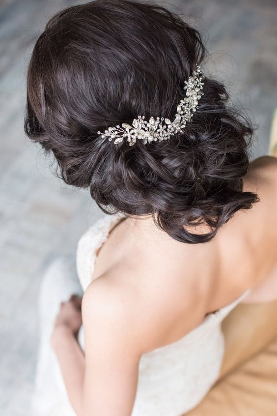 wavy updo with a hair vine of pearls and sparkling crystals