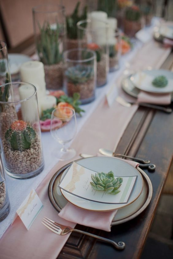 a desert tablescape with succulents and cacti and blush details
