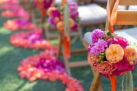 16 bold orange and pink blooms make for a dramatic aisle
