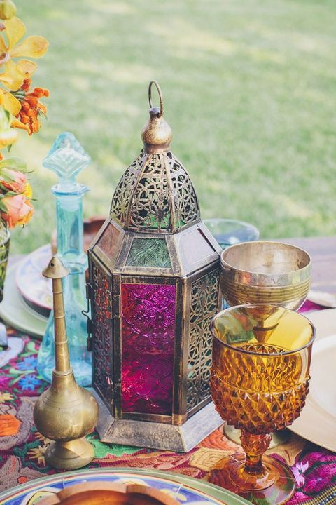 colorful glasses and a lantern on the table