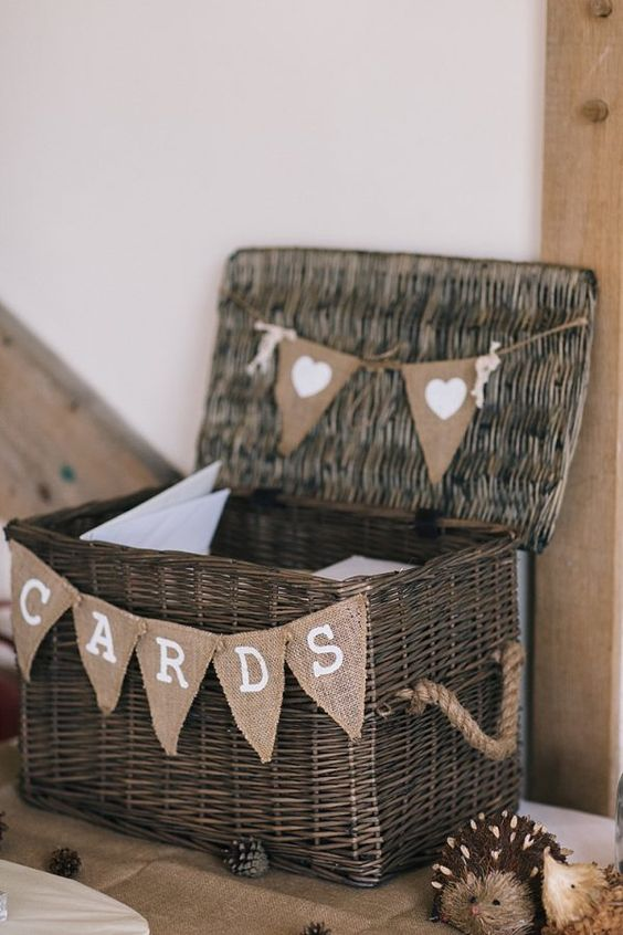 dark-colored woven box with a lid and burlap decor