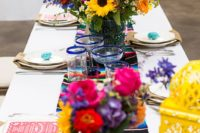 17 Mexican-themed table setting with a striped runner and bold florals