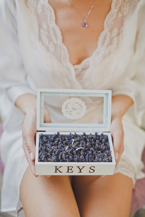 a vintage white key box with a glass lid filled with lavender