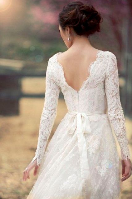 lace wedding dress with sleeves and a V cut back