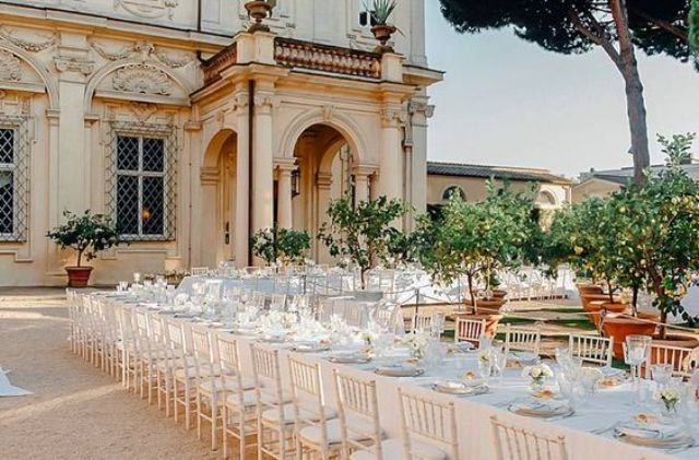 refined wedding table settings with some neutral florals