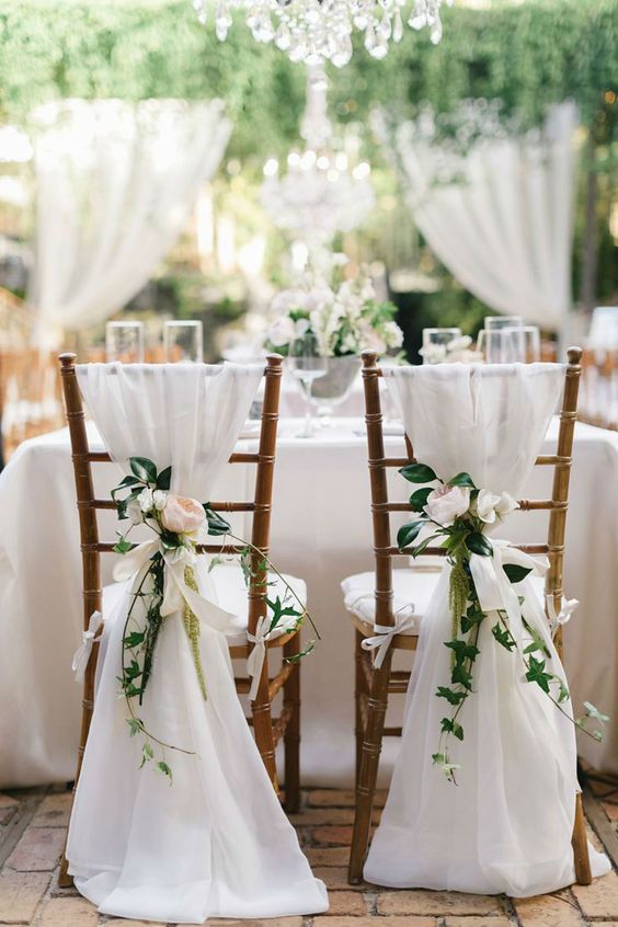 ethereal white fabric and floral posies for chair decor