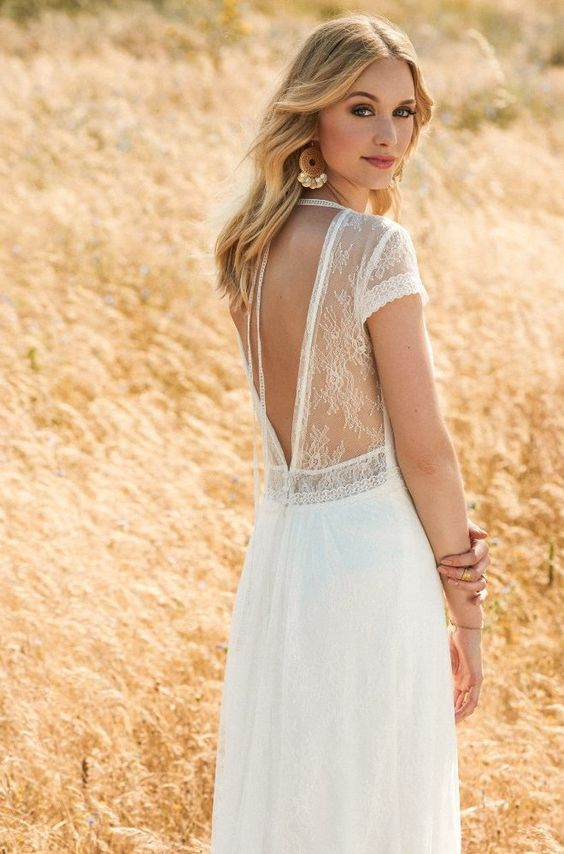 light lace wedding dress with an illusion V cut back
