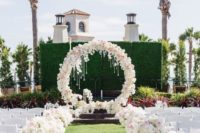 18 lush white flower aisle decor and a circle white flower arch with crystals