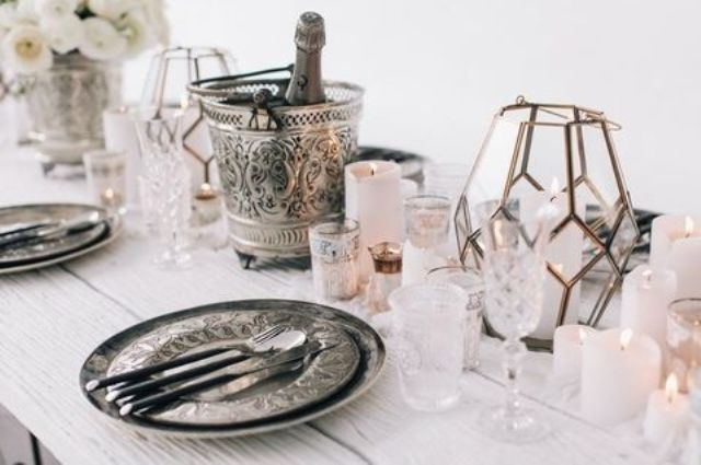 refined silverware, a candle lantern and plates with white look stunning