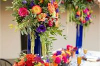 18 super bold tablescape with large flower arrangements will embrace your location