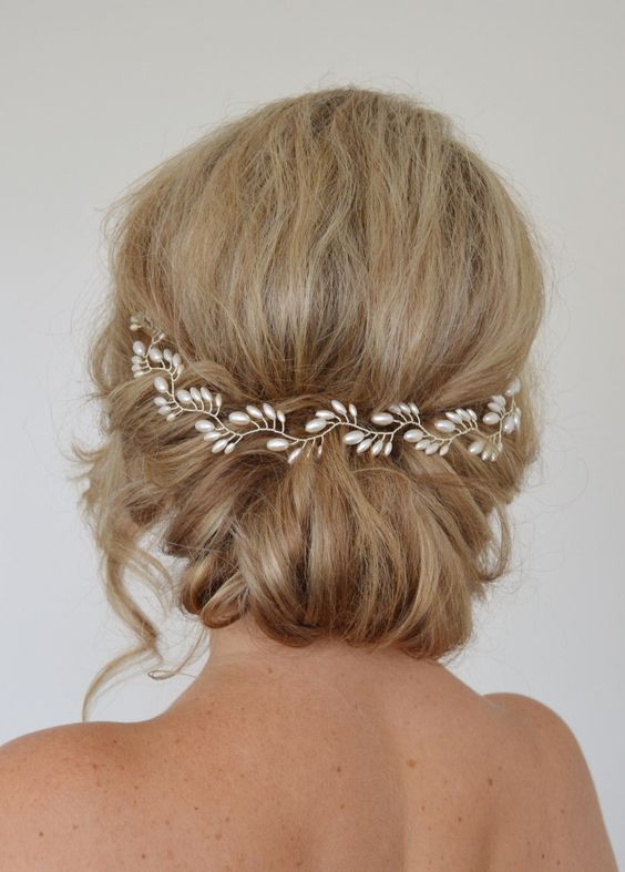 twisted bridal updo with a pearl hair vine for an elegant look