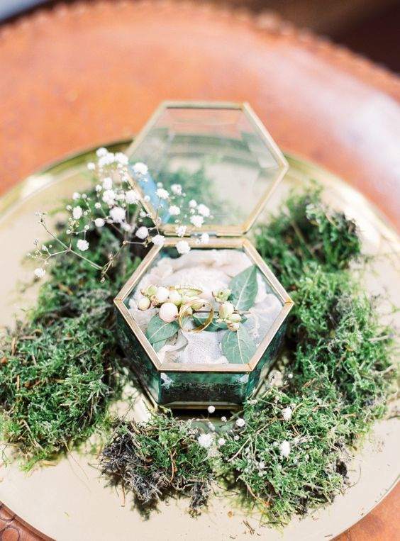 a vintage glass wedding box with leaves, berries and flowers