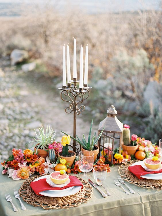 bold Mexican desert tablescape with cacti, succulents and fruit