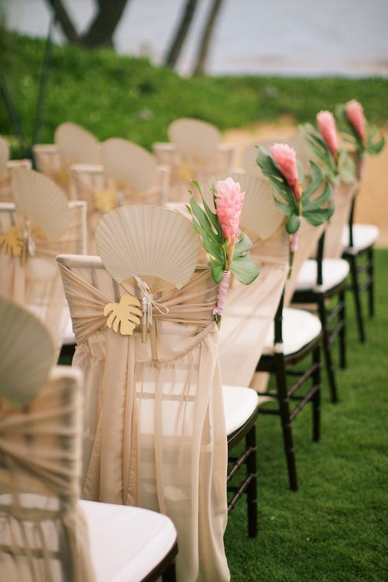 neutral fabric, wooden palm leaves and bold flowers