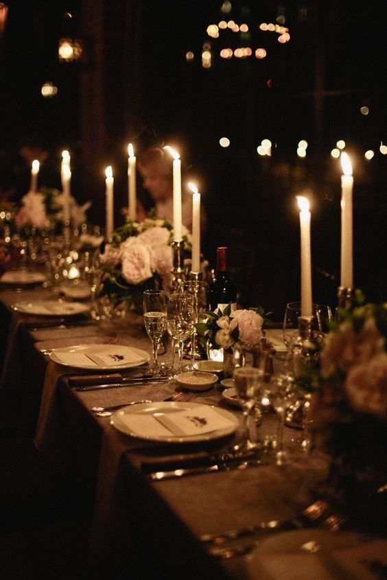 elegant table setting with candles and blush florals