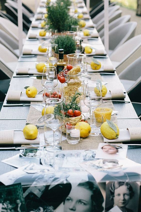 foodie tablescape with tomatoes, citrus and herbs