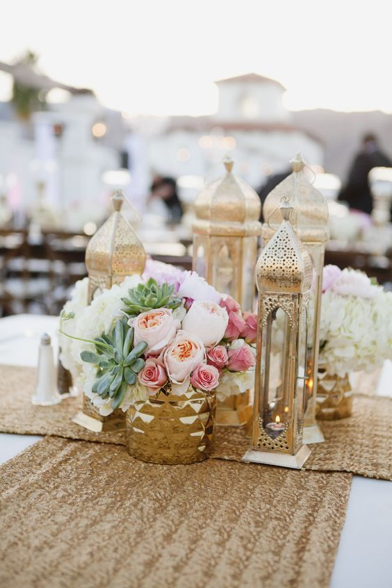 gold sequin table runners, flowers and gilded lanterns