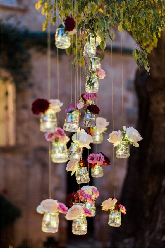 hanging flowers in jars are a simple and cute decoration for your venue