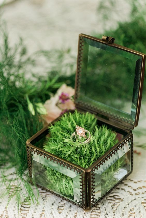 metal and glass wedding ring box with faux grass