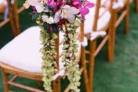 20 orchids and greenery aisle chair decor