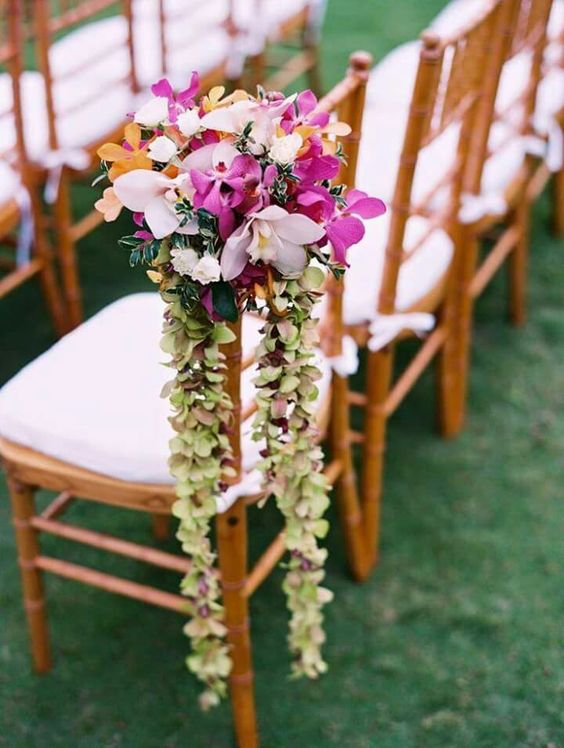 orchids and greenery aisle chair decor