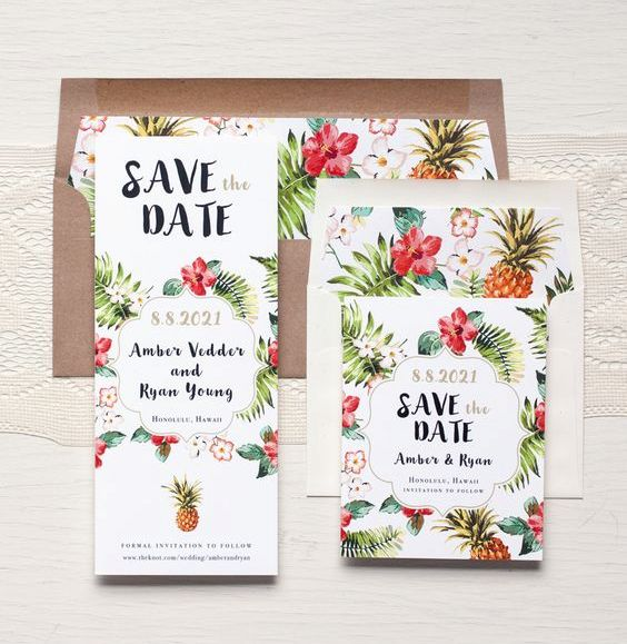 tropical flowers, leaves and pineapple prints on the wedding stationary